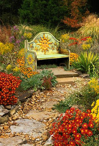 Mexican handmade bench in sun garden, midwest USA