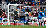 Hearts get gthe ball in the net as Rangers players appeal to the ref