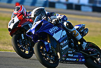Chris Clark (2) races Shane Narbonne (64) during the AMA SuperBike motorcycle race at Daytona International Speedway, Daytona Beach, FL, March 2011.(Photo by Brian Cleary/www.bcpix.com)