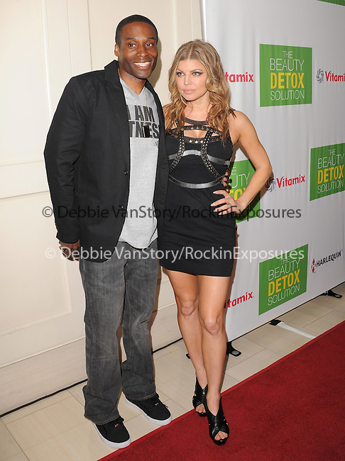 Fergie and her trainer Don Brooks at The The Beauty Detox Solution by Kimberly Snyder held at The London in West Hollywood, California on April 13,2011                                                                               © 2010 Hollywood Press Agency