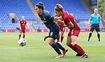 Jasmine Matthews of Liverpool Ladies pulls back Jess Sigsworth of Manchester United Women