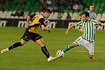 Sevilla, España, 15 de octubre de 2014: Julio Fernandez (I) avanza con el balon mientras Molinero (D) intenta frenarle durente el partido entre Real Betis y Lugo correspondiente a la jornada 5 de la Copa del Rey 2014-2015 celebrado en el estadio Benito Villamarain de Sevilla.