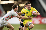 Harry Glover of England (left) tries to stop Lachie Anderson of Australia who runs with the ball during the match Australia vs England, the Bronze Final of Day 2 of the HSBC Singapore Rugby Sevens as part of the World Rugby HSBC World Rugby Sevens Series 2016-17 at the National Stadium on 16 April 2017 in Singapore. Photo by Victor Fraile / Power Sport Images