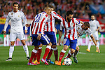 Atletico de Madrid's Joao Miranda and Arda Turan and Real Madrid´s Karim Benzema during quarterfinal first leg Champions League soccer match at Vicente Calderon stadium in Madrid, Spain. April 14, 2015. (ALTERPHOTOS/Victor Blanco)