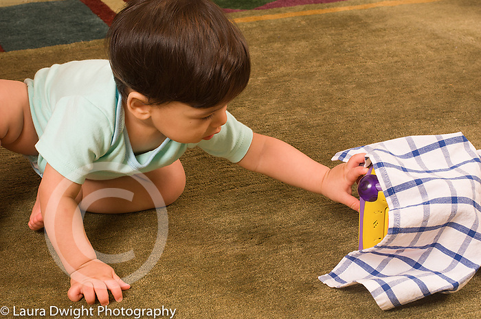 10 month old baby boy finding toy hidden under cloth Piaget object permanence horizontal biracial Asian Japanese and Caucasian