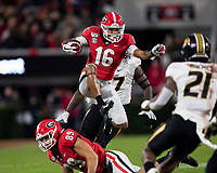 ATHENS, GA - NOVEMBER 09: Demetris Robertson #16 of the Georgia Bulldogs leaps over a teammate during a run during a game between Missouri Tigers and Georgia Bulldogs at Sanford Stadium on November 09, 2019 in Athens, Georgia.
