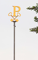 The flag pole at Chateau Petrus with the golden P and Peter keys and a tree in the background Pomerol Bordeaux Gironde Aquitaine France