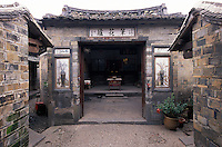 Inner shrine of a traditional Hakka round house in Hakka Village, Fujian Province, China. These fort-like structures house dozens of families and can be several hundreds of years old. .2004