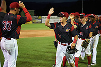 Batavia Muckdogs right fielder Zachary Daly (38) high fives Alejandro Mateo (37) after a game against the Auburn Doubledays on June 19, 2017 at Dwyer Stadium in Batavia, New York.  Batavia defeated Auburn 8-2 in both teams opening game of the season.  (Mike Janes/Four Seam Images)