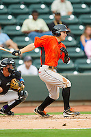 Johnny Ruettiger (14) of the Frederick Keys follows through on his swing against the Winston-Salem Dash at BB&T Ballpark on July 21, 2013 in Winston-Salem, North Carolina.  The Dash defeated the Keys 3-2.  (Brian Westerholt/Four Seam Images)