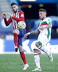 Atletico de Madrid's Yannick Carrasco (l) and Granada Club de Futbol's Cristiano Biraghi during La Liga match. April 17,2016. (ALTERPHOTOS/Acero)