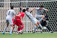Brandon Allen (10) of Georgetown takes a shot at Rafael Diaz (1) during the game at North Kehoe Field in Washington DC. Georgetown defeated St. John's, 2-1, in the Big East conference tournament quarterfinals.