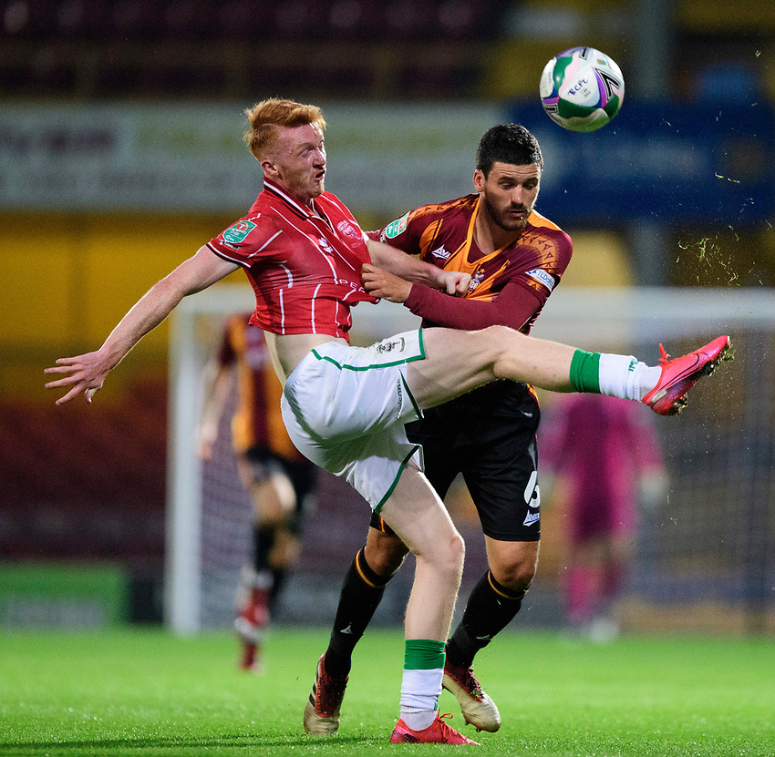 Lincoln City's Callum Morton battles with Bradford City's Anthony O'Connor<br /> <br /> Photographer Chris Vaughan/CameraSport<br /> <br /> Carabao Cup Second Round Northern Section - Bradford City v Lincoln City - Tuesday 15th September 2020 - Valley Parade - Bradford<br />  <br /> World Copyright © 2020 CameraSport. All rights reserved. 43 Linden Ave. Countesthorpe. Leicester. England. LE8 5PG - Tel: +44 (0) 116 277 4147 - admin@camerasport.com - www.camerasport.com
