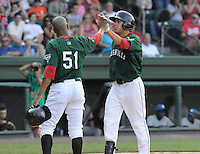 Outfielder Drew Turocy (28) of the Greenville Drive, right, is congratulated by Henry Ramos (51) after scoring a run in a game against the Asheville Tourists on Sunday, August 26, 2012, at Fluor Field at the West End in Greenville, South Carolina. Greenville won, 5-4. (Tom Priddy/Four Seam Images)