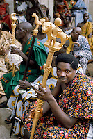 Tribal cousellors carrying the symbol of their office at a government ceremony in Ghana, Africa.