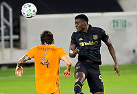 CARSON, CA - OCTOBER 28: Jesus David Murillo #94 of LAFC with a head ball during a game between Houston Dynamo and Los Angeles FC at Banc of California Stadium on October 28, 2020 in Carson, California.