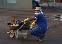 Brazilian Worker gets ready to go to work in  Stadium Amazonia