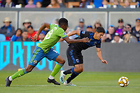 SAN JOSE, CA - SEPTEMBER 30: Kelvin Leerdam #18 of the Seattle Sounders FC defends Shea Salinas #6 of the San Jose Earthquakes during a Major League Soccer (MLS) match between the San Jose Earthquakes and the Seattle Sounders on September 30, 2019 at Avaya Stadium in San Jose, California.