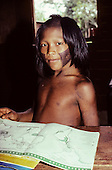 A-ukre village, Brazil. Pidjuri, a Kayapo boy, studying geography in the school; Xingu Indigenous Area, Para state.