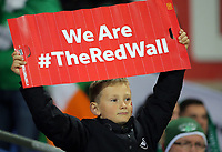 """A young Wales supporter with a """"We Are The Red Wall"""" clapper during the FIFA World Cup Qualifier Group D match between Wales and Republic of Ireland at The Cardiff City Stadium, Wales, UK. Monday 09 October 2017"""