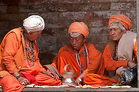 Pashupatinath, Nepal.  Sadhus,  Hindu Ascetics, Converse in a Pati, an Open-air Resting Place.