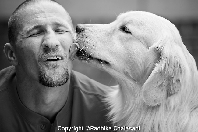 BEACON, NEW YORK-AUGUST 15: Rezzie plays affectionately with Andy. Andy has a great bond with Rezzie, the second dog he is raising for the Puppies Behind Program at Fishkill Correctional Facility. He says it's like losing a member of your family when the dog you've trained and lived with for 18-20 month leaves the prison.