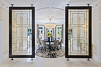 BNPS.co.uk (01202 558833)<br /> Pic: Savills/BNPS<br /> <br /> Pictured: A dining room.<br /> <br /> A striking turreted French style chateau in one of the UK's most desirable streets is on the market for £9.25m.<br /> <br /> Deauville is an impressive mansion with a striking period exterior but a stylish contemporary look inside and all the mod cons a home owner would want, including an indoor pool complex and cinema room.<br /> <br /> The house is in the prestigious St George's Hill estate in Weybridge, Surrey, which is renowned all over the world.<br /> <br /> The five-bedroom house was built in 2000 but has undergone an extensive refurbishment in the last few years.