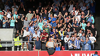 Brighton fans celebrate their late goal scored by Leandro Trossard during Brentford vs Brighton & Hove Albion, Premier League Football at the Brentford Community Stadium on 11th September 2021
