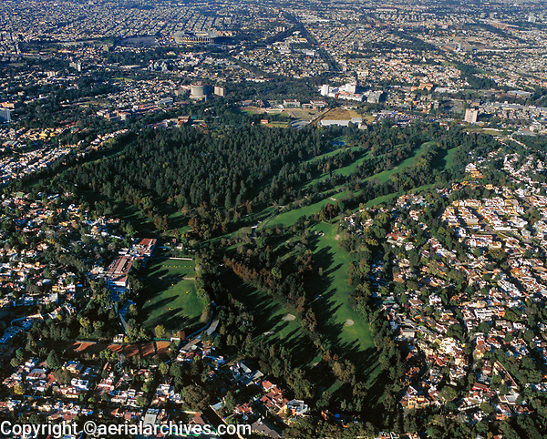 aerial photograph of the Club de Golf Mexico, Mexico Golf Club, Tlalpan, Mexico City, Mexico, the Aztec stadium is visible in the background