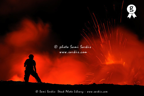 Woman watching lava eruption on crater edge (Licence this image exclusively with Getty: http://www.gettyimages.com/detail/84745826 )