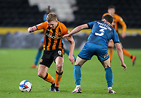 Grimsby Town's Danny Preston is tackled by Hull City's Daniel Batty<br /> <br /> Photographer Alex Dodd/CameraSport<br /> <br /> EFL Papa John's Trophy - Northern Section - Group H - Hull City v Grimsby Town - Tuesday 17th November 2020 - KCOM Stadium - Kingston upon Hull<br />  <br /> World Copyright © 2020 CameraSport. All rights reserved. 43 Linden Ave. Countesthorpe. Leicester. England. LE8 5PG - Tel: +44 (0) 116 277 4147 - admin@camerasport.com - www.camerasport.com