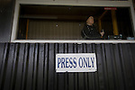 Prescot Cables 2 Brighouse Town 1, 13/02/2016. Hope Street, Northern Premier League. The announcer standing in the press box in the stadium before Prescot Cables played Brighouse Town in a Northern Premier League division one north fixture at Valerie Park. Founded in 1884, the 'Cables' in their name came from the largest local employer, British Insulated Cables and they have played in their current ground, also known as Hope Street, since 1906. Prescott won the match 2-1 watched by a crowd of 189. Photo by Colin McPherson.