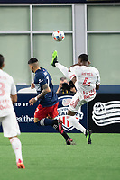 FOXBOROUGH, MA - MAY 22: Andres Reyes #4 of New York Red Bulls kicks the ball away from his goal under pressure from Gustavo Bou #7 of New England Revolution during a game between New York Red Bulls and New England Revolution at Gillette Stadium on May 22, 2021 in Foxborough, Massachusetts.