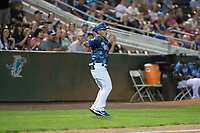 Ogden Raptors manager Jeremy Rodriguez (7) waves a runner home during a Pioneer League game against the Billings Mustangs at Lindquist Field on August 17, 2018 in Ogden, Utah. The Billings Mustangs defeated the Ogden Raptors by a score of 6-3. (Zachary Lucy/Four Seam Images)