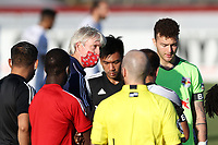 RICHMOND, VA - SEPTEMBER 30: Head coach John Wolyniec of New York Red Bulls II talks to his team during a hydration break during a game between North Carolina FC and New York Red Bulls II at City Stadium on September 30, 2020 in Richmond, Virginia.