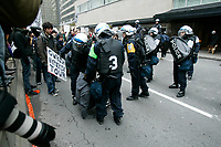 Montreal (Qc) Canada - October 22 2009-Demonstrators in front the Queen-Elizabeth hotel where George Bush speak in Montreal threw shoes and burned an effigy of the former US President.