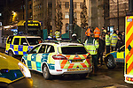 © Joel Goodman - 07973 332324 .15/12/2011 . Manchester , UK . Police, firefighters and paramedics attend St Peter's Square tram stop in central Manchester after an accident in which a man , identified as Gary Thompson , falls to his death under a tram . Photo credit: Joel Goodman
