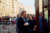East Berlin, East Germany<br /> November 10, 1989 <br /> <br /> East Germans line up at the Check Point Charlie border crossing into West Berlin. The East German government lifted travel and emigration restrictions to the West the night before.