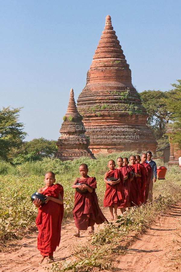 Myanmar, Burma. Bagan.  Young Novice Monks with Begging Bowls, Seeking Morning Food.