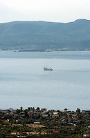 A small cargo boat crosses through the south Euboean bay near the seaside village of Agioi Apostoloi, 50 kilometres north-east of Athens Greece, and overlooking Eretria
