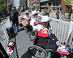 Calgary, AB - June 6 2014 - Wheelchair Culing's Mark Ideson, Dennis Thiessen and Ina Forrest wave to the fans during the Celebration of Excellence Parade of Champions. (Photo: Matthew Murnaghan/Canadian Paralympic Committee)