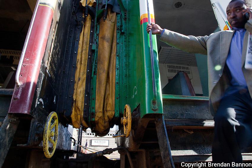 A passenger disembarking from a commuter train in Nairobi, Kenya.