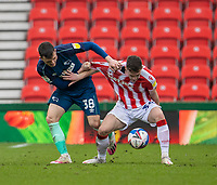 20th March 2021; Bet365 Stadium, Stoke, Staffordshire, England; English Football League Championship Football, Stoke City versus Derby County; Jordan Thompson of Stoke City under pressure from Jason Knight of Derby County