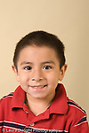 portrait headshot of preschool boy age 4 or 5 vertical