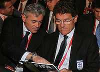 England head coach Fabio Capello (R) and assistant coach Franco Baldini (L) during the FIFA Final Draw for the FIFA World Cup 2010 South Africa held at the Cape Town International Convention Centre (CTICC) on December 4, 2009.