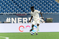 FOXBOROUGH, MA - AUGUST 5: Malick Mbaye #5 of North Carolina FC passes the ball during a game between North Carolina FC and New England Revolution II at Gillette Stadium on August 5, 2021 in Foxborough, Massachusetts.