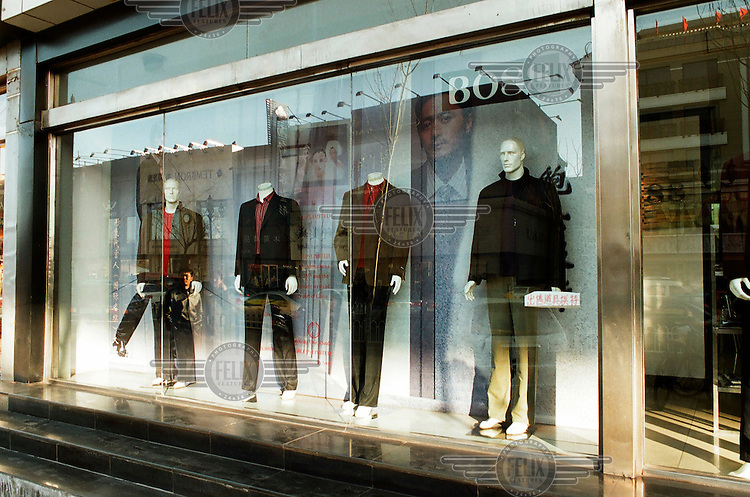 A window display in a shop called BO88, that sells imitation Hugo Boss clothing.