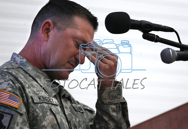 Master Sgt. Paul Kinsey speaks at a memorial ceremony for three Nevada National Guard members killed earlier this week by a gunman in an IHOP restaurant. An estimated 700 people attended the ceremony in Carson City, Nev., Sunday afternoon, Sept. 11, 2011. (AP Photo/Cathleen Allison)