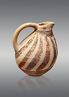 Minoan Kamares Ware ewer jug with  polychrome decorations, Phaistos Palace 1800-1600 BC; Heraklion Archaeological  Museum, grey background.<br /> <br /> This style of pottery is named afetr Kamares cave where this style of pottery was first found