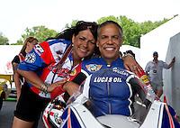Jun. 2, 2013; Englishtown, NJ, USA: NHRA pro stock motorcycle rider Hector Arana Sr (right) with a crew member during the Summer Nationals at Raceway Park. Mandatory Credit: Mark J. Rebilas-